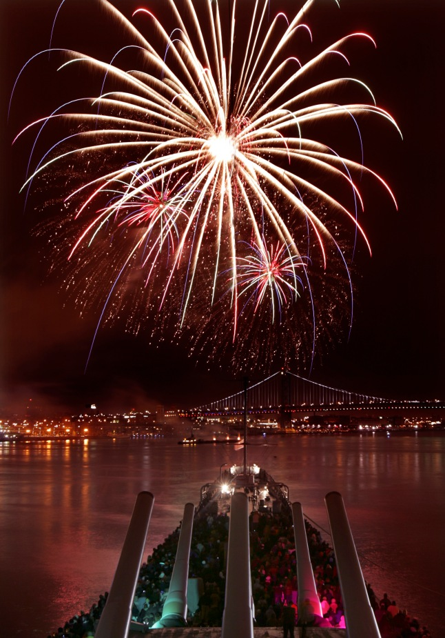 New Year's Eve fireworks:A view from the Battleship New Jersey shows New Year's Eve fireworks illuminating the Philadelphia skyline, the Benjamin Franklin Bridge and the tranquil Delaware River. Credit: Photo by R. Kennedy for GPTMC