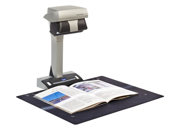 The new ScanSnap SV600 scanning a magazine.  (PRNewsFoto/Fujitsu Computer Products of America, Inc.)