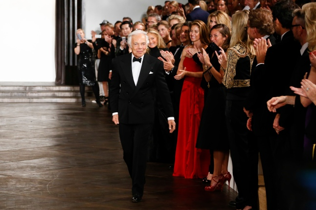 Ralph Lauren acknowledges applause following the presentation of the Ralph Lauren Fall 13 Collection Show at Les Beaux-Arts de Paris on October 8, 2013 in Paris, France. On this occasion Ralph Lauren celebrates the restoration project and patron sponsorship of L'Ecole des Beaux-Arts.  (Photo by Julien Hekimian/Getty Images for Ralph Lauren)