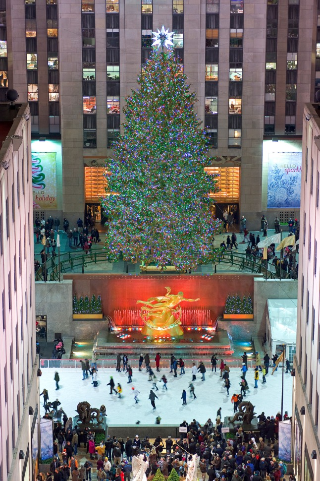 The Rink at Rockefeller Center with skaters under the iconic Christmas Tree.  (PRNewsFoto/The Rink at Rockefeller Center)