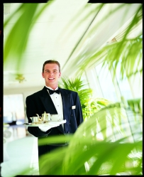 Waiter Serving Afternoon Tea