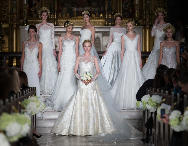 NEW YORK - NOVEMBER 12: Grand finale on runway for the 2014 Atelier collection by Pronovias at St. James Church on November 12, 2013 in New York City (Phot Credit: Lev Radin