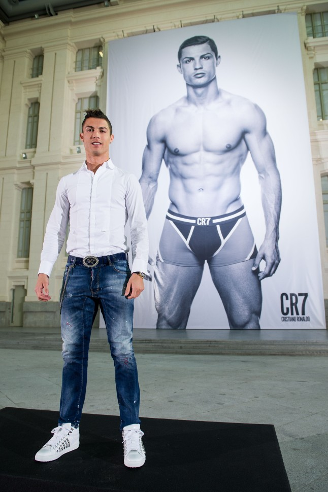 MADRID, SPAIN - OCTOBER 31: Cristiano Ronaldo poses in front of a 19m high billboard during the global launch of the CR7 by Cristiano Ronaldo Underwear line at the Palacio de Cibeles on October 31, 2013 in Madrid, Spain. CR7 by Cristiano Ronaldo is available worldwide from 1st November 2013 from www.cr7underwear.com (Photo by David Ramos/Getty Images for CR7)