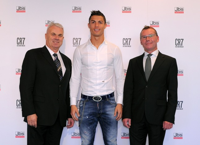 MADRID, SPAIN - OCTOBER 31: Cristiano Ronaldo (C) is accompanied by Claus Bjerg Sorensen (L) and Michael Alstrup of JBS textile group to officially launche his CR7 by Cristiano Ronaldo underwear line with a private event in Madrid on October 31, 2013 in Madrid, Spain. (Photo by Denis Doyle/Getty Images for CR7)