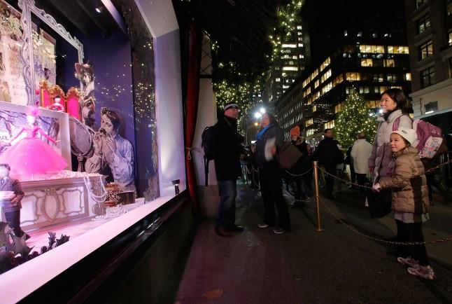 NEW YORK, NY - NOVEMBER 13:  Yumako and Leamiyu look at holiday windows at the Lord & Taylor Flagship Holiday Window Unveiling on November 13, 2013 in New York City.  (Photo by Jemal Countess/Getty Images for Lord & Taylor)