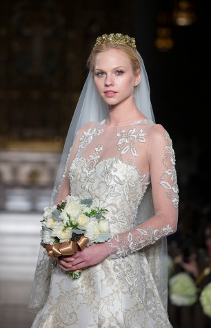 NEW YORK - NOVEMBER 12: Model walks runway for the 2014 Atelier collection by Pronovias at St. James Church on November 12, 2013 in New York City
