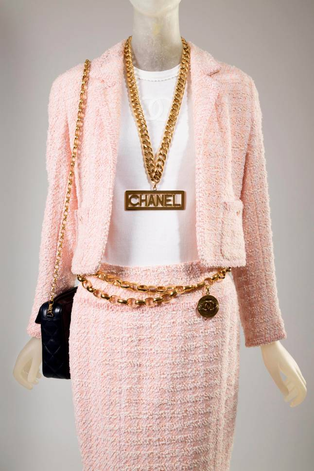 Chanel (Karl Lagerfeld), suit, pink wool and synthetic blends, white cotton, spring 1994, France, gift of Chanel Inc.  Chanel (Karl Lagerfeld), necklace, gold plated metal, fall 1991, France, Gift of Depuis 1924