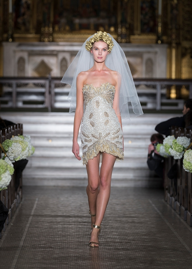 NEW YORK - NOVEMBER 12: Model walks runway for the 2014 Atelier collection by Pronovias at St. James Church on November 12, 2013 in New York City (Photo Credit: Lev Radin)