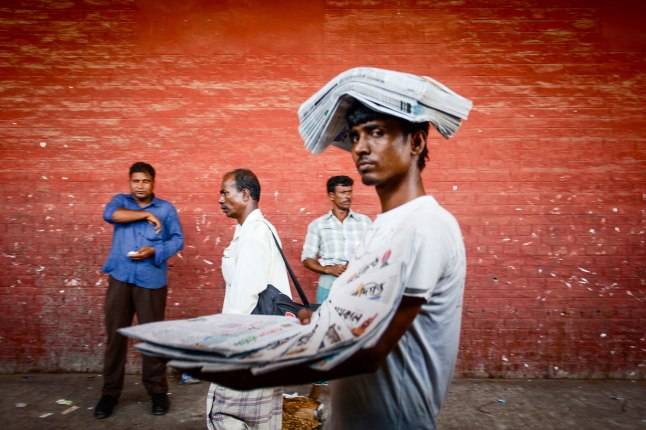 ''Paperman'' by Md Farhad Rahman, Bangladesh. Second Prize. This man earns an income selling daily papers in a railway station. Selling papers is a common form of self-employment in Bangladesh