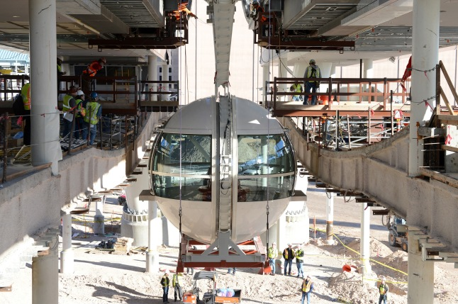 Technical precision and detailed planning go into attaching the first passenger cabin to the rim of the Las Vegas High Roller observation wheel. Photo Credit: Denise Truscello