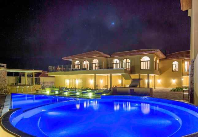 grace cafayate pool by night