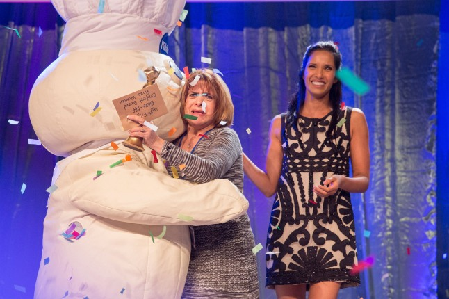 "Million Dollar Moment -- Glori Spriggs receives a hug from the Pillsbury Doughboy(TM) after being named the grand prize winner of the 46th Pillsbury Bake-Off(R) Contest on Monday, November 11, 2013 in Las Vegas. Contest host Padma Lakshmi looks on. Spriggs will appear on ""The Queen Latifah Show"" on Thursday, November 14, 2013. (PRNewsFoto/Pillsbury)"