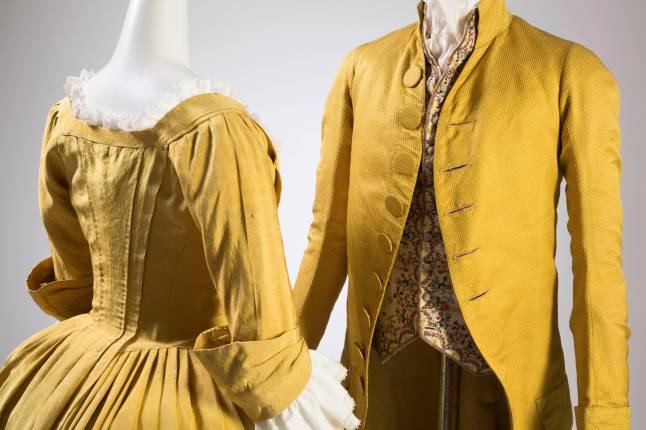 (left) Dress, yellow silk faille, circa 1770, USA (possibly), museum purchase, (right) Men's coat, yellow silk, circa 1790,  USA (possibly), museum purchase