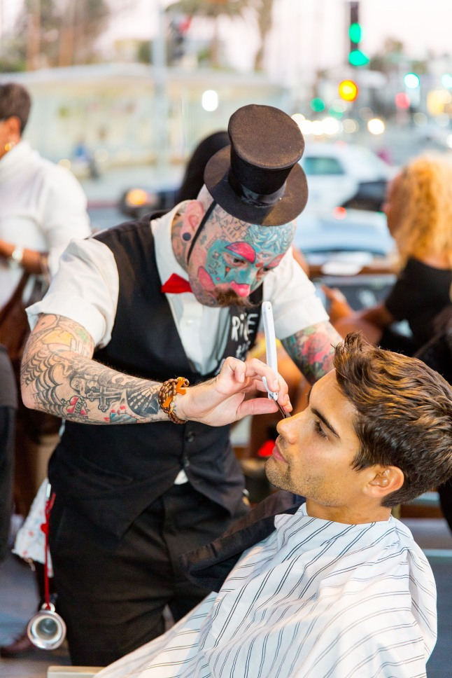 Richie the Barber gives James Ryan a clean shave at Del Frisco's Grille in Santa Monica to start Movember.  (PRNewsFoto/Del Frisco's Grille)