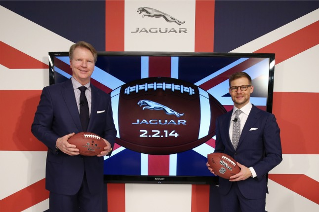 """Phil Simms, CBS sports lead NFL analyst and Super Bowl XXI MVP, joined Jeff Curry, Brand Vice President, Jaguar North America, to announce Jaguar's first television commercial for broadcast in the Super Bowl, at The London NYC in New York City on November 7, 2013. The spot is part of a new brand and product advertising campaign, themed """"British Villains,"""" for the launch of the new Jaguar F-TYPE Coupe. (PRNewsFoto/Jaguar)"""