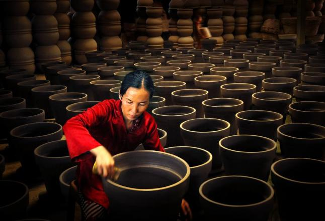 Production of Ceramic, Vietnam. This woman was able to establish this small craft workshop through the government's financial assistance. Photo by Van Bang Vo