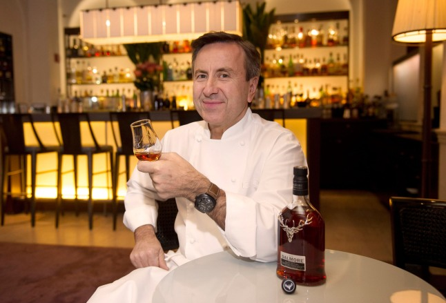 Chef Daniel Boulud with The Dalmore Selected by Daniel Boulud bottle and liquid.  (PRNewsFoto/The Dalmore)