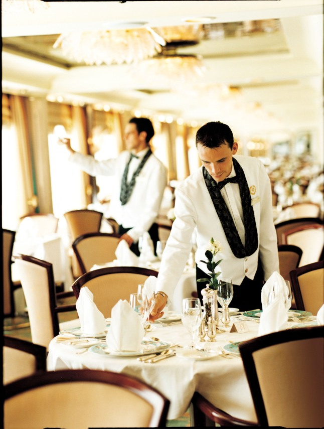 A Crystal waiter in the Crystal Dining Room. (PRNewsFoto-Crystal Cruises)