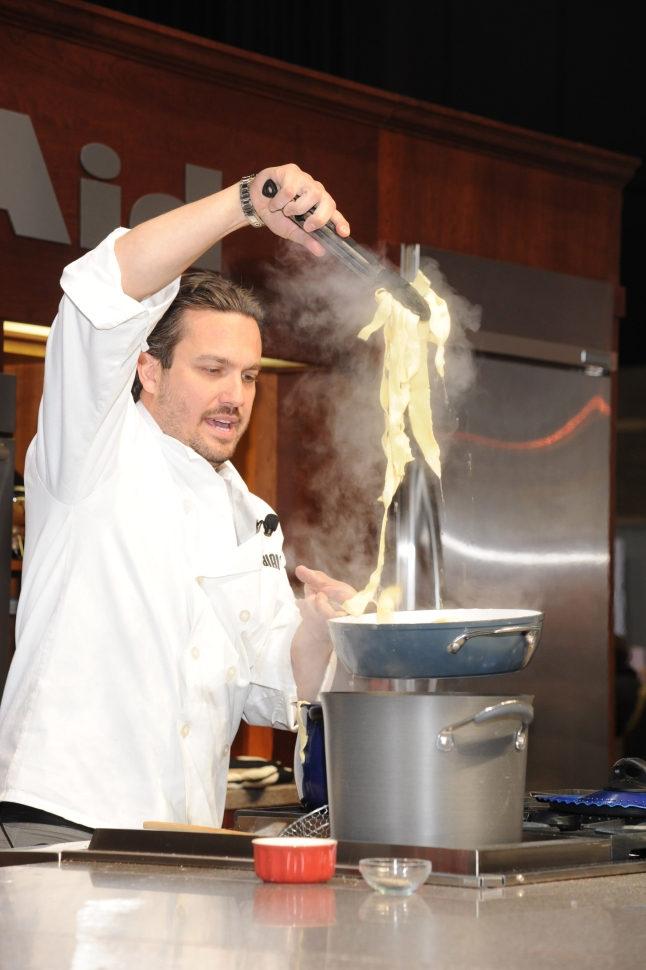 Chef Fabio Viviani prepares pasta at the Show's Cooking Theater at 2013 International Home + Housewares Show