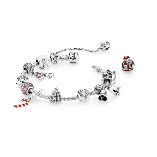 Get in the holiday spirit with new sterling silver charms and pendants, including traditional yuletide symbols — a snow globe, a Christmas tree, a striped candy cane, and a silver bells dangle.