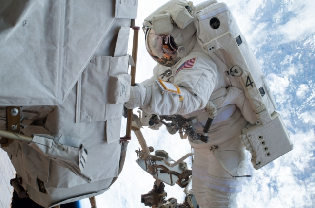 Astronaut Mike Hopkins Participates in Spacewalk ISS038-E-020277 (24 Dec. 2013) --- NASA astronaut Mike Hopkins, Expedition 38 flight engineer, participates in the second of two spacewalks, spread over a four-day period, which were designed to allow the crew to change out a faulty water pump on the exterior of the Earth orbiting International Space Station. He was joined on both spacewalks by NASA astronaut Rick Mastracchio.