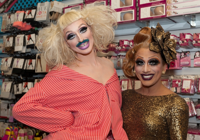 NEW YORK - DECEMBER 17: Bianca Del Rio and Milk of RuPaul Drag Race attend reveal of RuPaul cosmetics line & themed window at Ricky's NYC on December 17, 2013 in New York City.