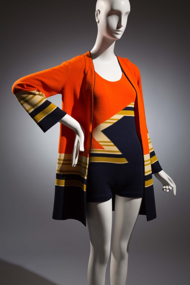 Munchen, Swim suit, Wool, Circa 1930, Germany, The Museum at FIT, P83.8.9, Museum Purchase (     Maillot: orange and navy with off-white and green, large zigzag and stripe patterned wool jersey ; tank top with lower scoop neck back; one button left shoulder seam closing. Jacket: orange and navy with off-white and green striped wool jersey; V neck with navy trim; straightline; long sleeve.)