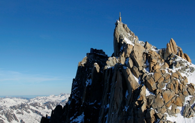 "Distant view of the ""Step into the Void"" installation at the Aiguille du Midi mountain peak above Chamonix, in the French Alps, on December 17, 2013. The glass room will open to the public on December 21, 2013. (Reuters/Robert Pratta)"