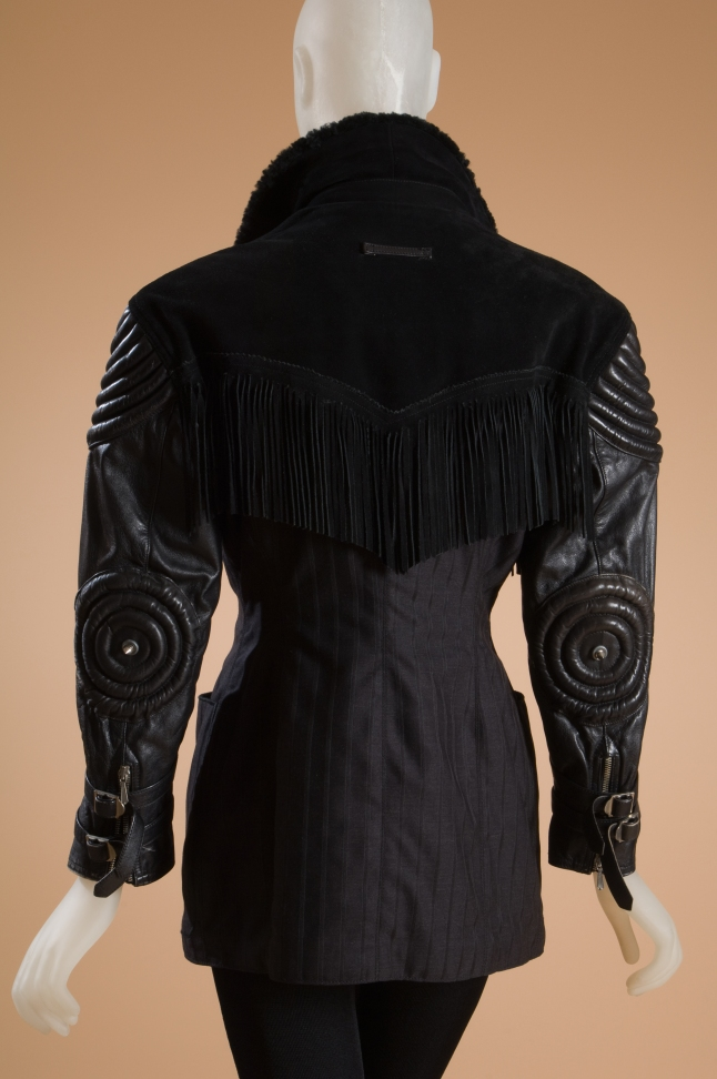 Jean Paul Gaultier, jacket, black leather, faux fur, suede, and grey wool, 1987, France. Gift of Anne M. Zartarian, 2000.23.10.