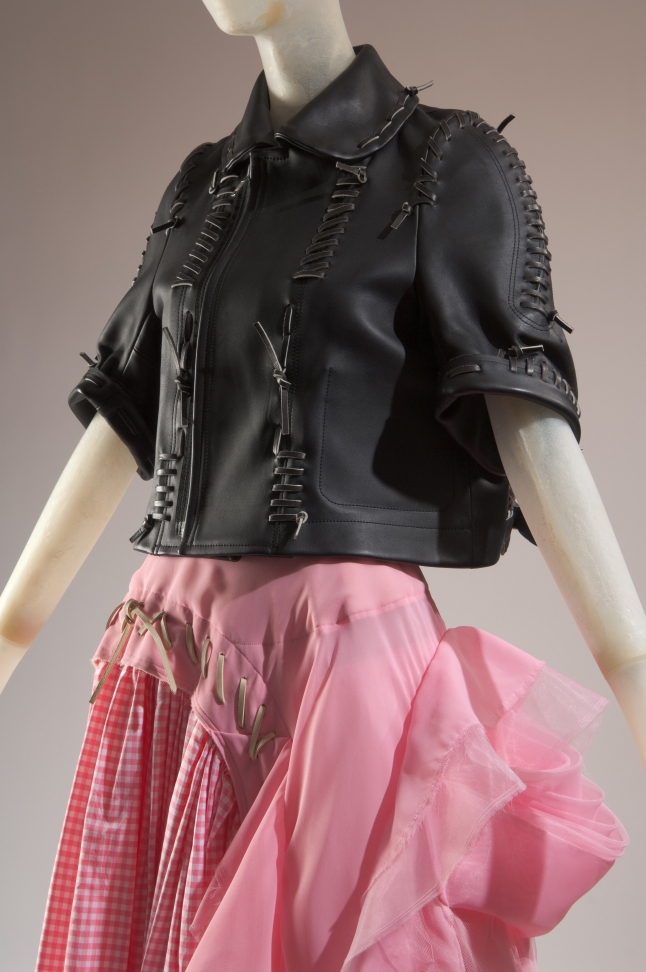 Comme des Garçons (Rei Kawakubo), jacket and skirt, black leather, pink gingham and tulle, spring 2005, Japan. Museum purchase, 2005.49.1.