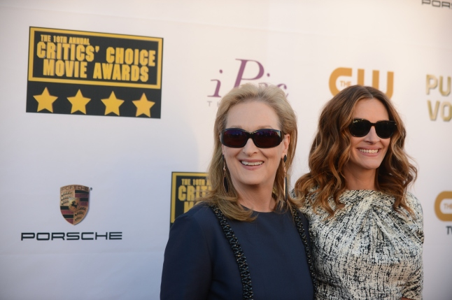 Meryl Streep and Julia Roberts arrives at the 19th annual Critics' Choice Movie Awards at the Barker Hangar on Thursday, Jan. 16, 2014, in Santa Monica, Calif. (Photo by Jordan Strauss/Invision/AP)