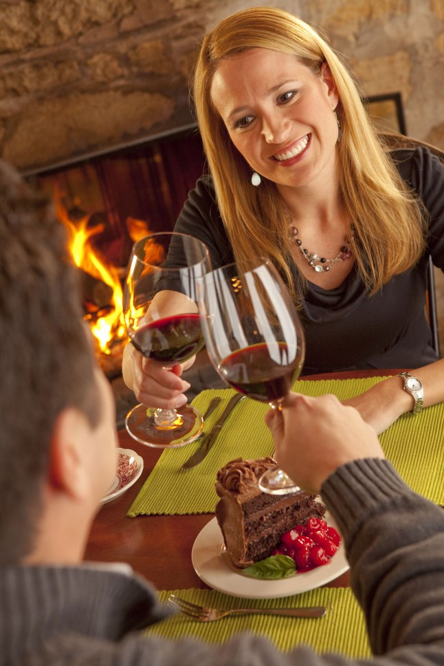 A couple dines fireside at one of Door County's cozy restaurants during the annual Nature of Romance promotion in Door County, Wisconsin. Photo courtesy Mike Roemer/DoorCounty.com.