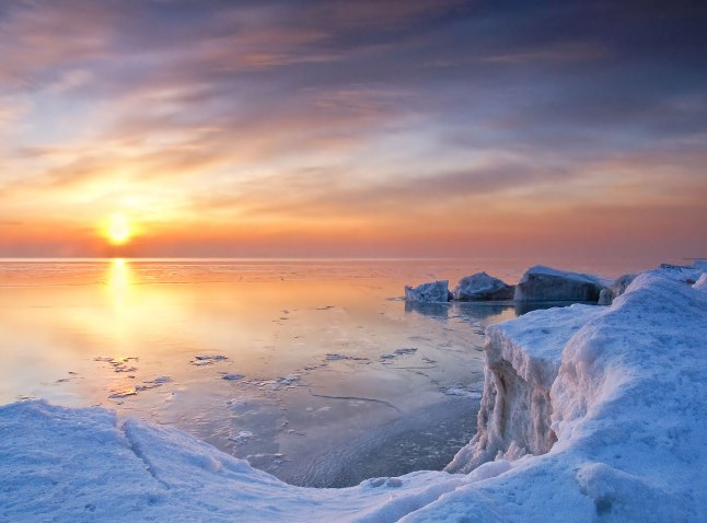 The sun rises over Lake Michigan at Whitefish Dunes State Park on a crisp winter morning in Door County, Wisconsin. Capture Door County photo courtesy Markos Berndt.