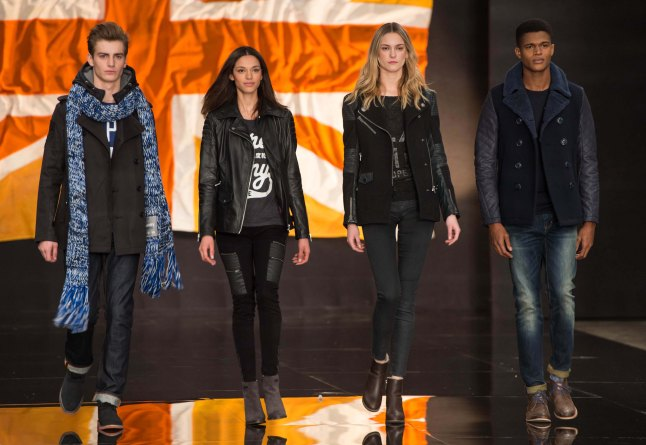 LONDON, ENGLAND - JANUARY 07:  Models walk the runway at the Superdry show during The London Collections: Men Autumn/Winter 2014 at the Old Sorting Office on January 7, 2014 in London, England.  (Photo by Ian Gavan/Getty Images for Superdry)