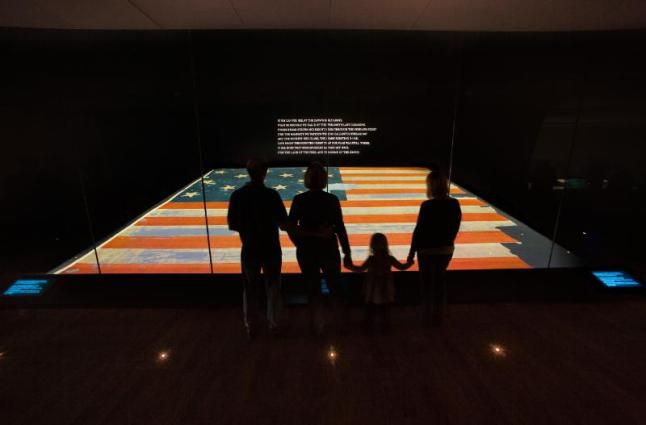 The Star Spangled Banner, the flag that inspired the national anthem, on display at the Smithsonian's National Museum of American History.  (PRNewsFoto/Smithsonian's National Museum of American History)