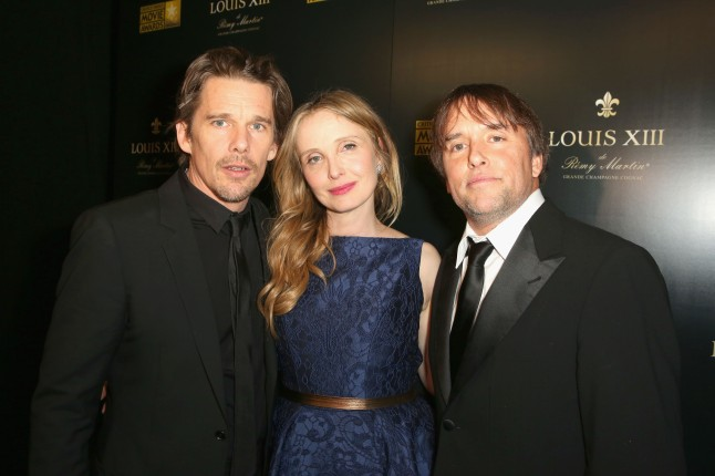 SANTA MONICA, CA - JANUARY 16:  (L-R) Actors-screenwriters Ethan Hawke and Julie Delpy and director-screenwriter Richard Linklater, winners of the Critics' Choice LOUIS XIII Genius Award during the 19th Annual Critics' Choice Movie Awards at Barker Hangar on January 16, 2014 in Santa Monica, California.  (Photo by Ari Perilstein/Getty Images for LOUIS XIII)