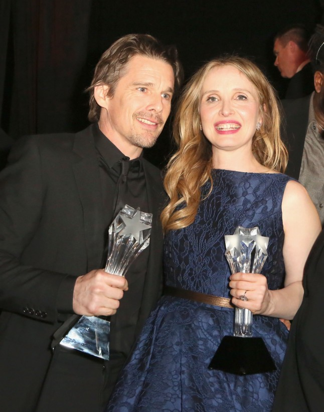 SANTA MONICA, CA - JANUARY 16:  Actors-screenwriters Ethan Hawke (L) and Julie Delpy, winners of the Critics' Choice LOUIS XIII Genius Award during the 19th Annual Critics' Choice Movie Awards at Barker Hangar on January 16, 2014 in Santa Monica, California.  (Photo by Ari Perilstein/Getty Images for LOUIS XIII)