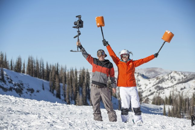 """Olympic gold medalist and mogul skier Hannah Kearney poses with YouTube sensation Devin """"Super Tramp"""" Graham during her Bear Naked® #OneUpIt video shoot at Wolf Creek Ski Area"""