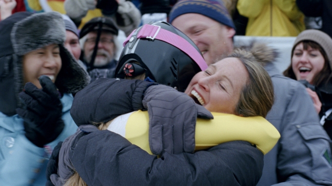 "Image from Pick Them Back Up. Athlete and Mom Embrace: A scene from the latest installment in the P&G Thank You Mom campaign. ""Pick Them Back Up"" is a short film that shows an athlete's journey to achieve their dreams and the important role moms play along the way. (Photo: Business Wire)"