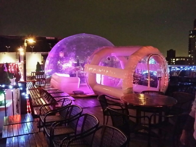 New weather-proof bubble tent igloo on 230 FIFTH's roof deck overlooking Manhattan skyline.  (PRNewsFoto/230 FIFTH)
