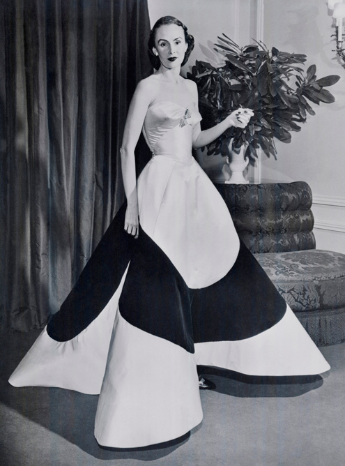 """Austine Hearst in Charles James """"Four Leaf Clover"""" Gown, ca. 1953 Courtesy of The Metropolitan Museum of Art, Photographer Unknown, © Bettmann/CORBIS"""