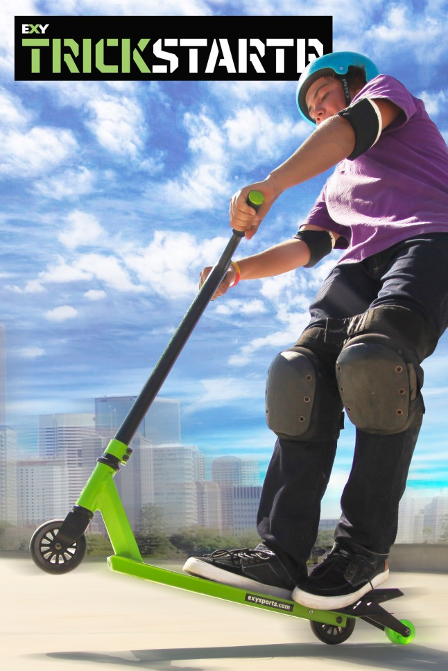 EXY Trickstartr, part of the new EXY Extreme Yvolution series, is a stunt scooter for beginner riders who want to learn how to master basic tricks.  It features a slick matte black/vibrant color design and comes with a special patent-pending device that allows riders to do a manual (wheelie).  (PRNewsFoto/Yvolution)