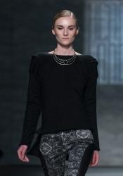 NEW YORK, NY - FEBRUARY 13, 2014: Model walks runway for Hernan