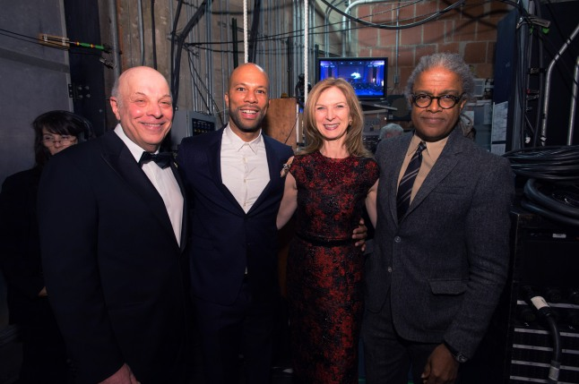 "Academy Governor Charles Fox, host Common, Academy CEO Dawn Hudson and film critic Elvis Mitchell during the Academy of Motion Picture Arts and Sciences' ""The Oscar Concert"" on Thursday, February 27, 2014 at Royce Hall in Los Angeles. The Oscars® will be presented on Sunday, March 2, 2014, at the Dolby Theatre® in Hollywood, CA and televised live by the ABC Television Network."