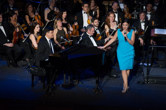 "Oscar® nominees Robert Lopez and Kristen Anderson-Lopez performs ""Let It Go"" from the film ""Frozen"" during the Academy of Motion Picture Arts and Sciences' ""The Oscar Concert"" on Thursday, February 27, 2014 at Royce Hall in Los Angeles."