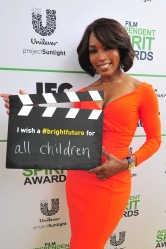 SANTA MONICA, CA - MARCH 01: Actress Angela Bassett calls ACTION! to create a brighter future for all children on the Yellow Carpet presented by Unilever Project Sunlight during the 2014 Film Independent Spirit Awards at Santa Monica Beach on March 1, 2014 in Santa Monica, California.  (Photo by Mark Sullivan/WireImage)