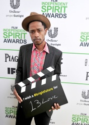 SANTA MONICA, CA - MARCH 01: Actor Keith Stanfield calls ACTION! to create a brighter future on the Yellow Carpet presented by Unilever Project Sunlight during the 2014 Film Independent Spirit Awards at Santa Monica Beach on March 1, 2014 in Santa Monica, California.  (Photo by Mark Sullivan/WireImage)