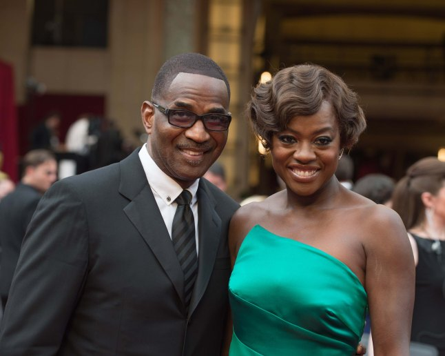 Julius Tennon (left) and Viola Davis arrive for the live ABC Telecast of The 86th Oscars® at the Dolby® Theatre on March 2, 2014 in Hollywood, CA.