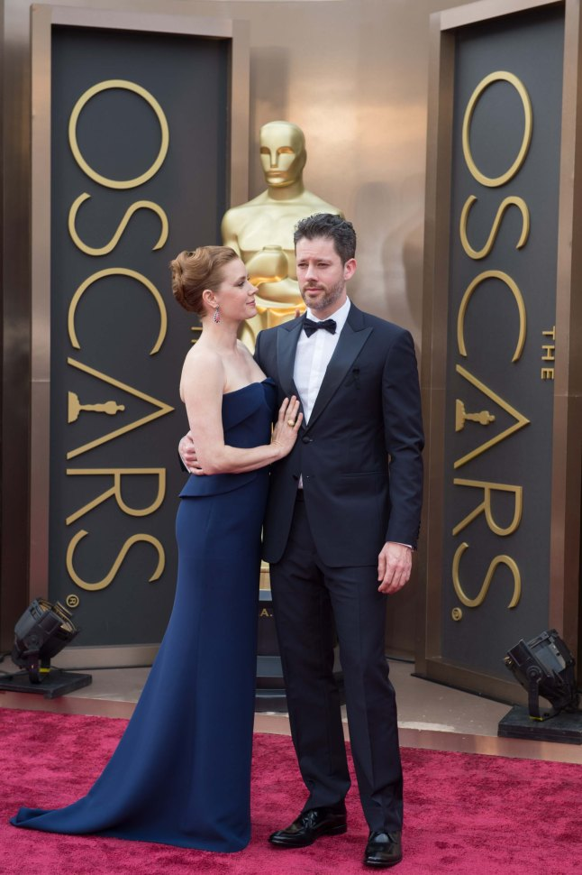 Oscar®-nominee Amy Adams and Darren Le Gallo arrive for the live ABC Telecast of The 86th Oscars® at the Dolby® Theatre on March 2, 2014 in Hollywood, CA.