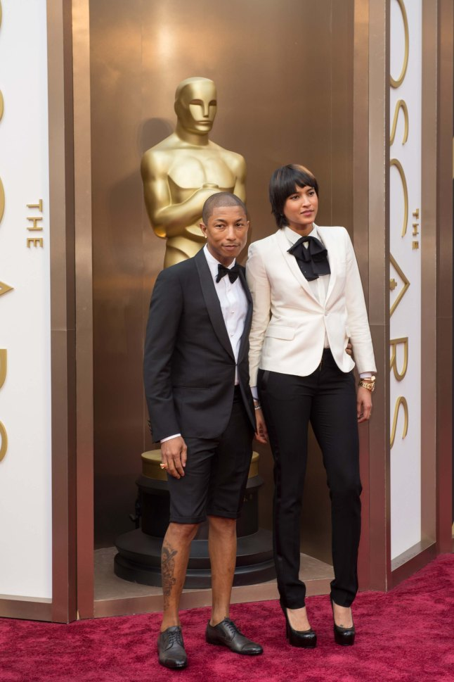Oscar®-nominee Pharrell Williams and wife arrive for the live ABC Telecast of The 86th Oscars® at the Dolby® Theatre on March 2, 2014 in Hollywood, CA.
